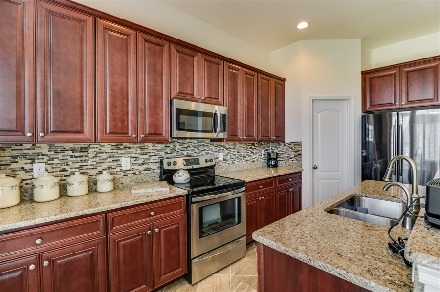 Real Estate Photography - 7771 Clydesdale Ct, Milford, DE, 19963 - 42' cabinets, pantry, backsplash