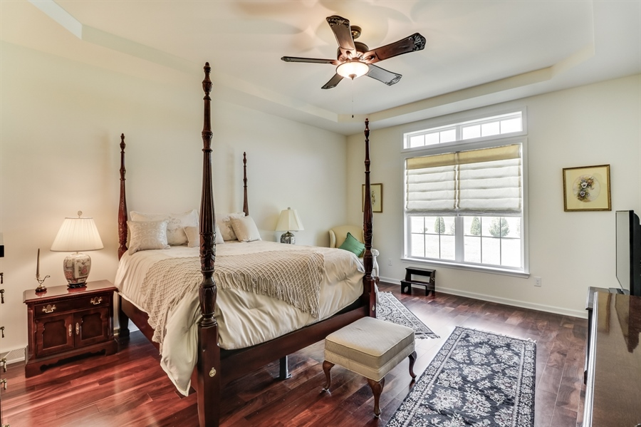 Real Estate Photography - 7771 Clydesdale Ct, Milford, DE, 19963 - Master bedroom w/hardwood floor and tray ceiling