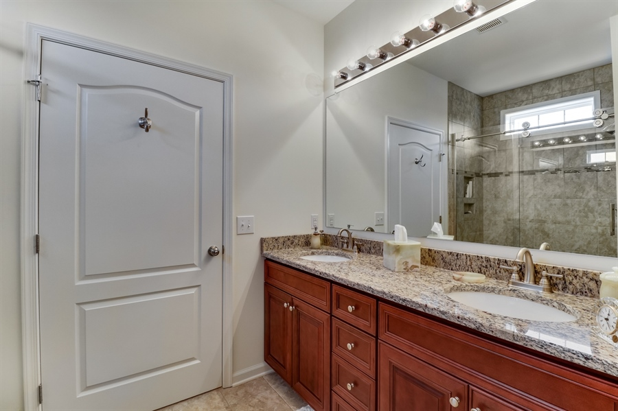 Real Estate Photography - 7771 Clydesdale Ct, Milford, DE, 19963 - Master bath has double vanity w/granite countertop