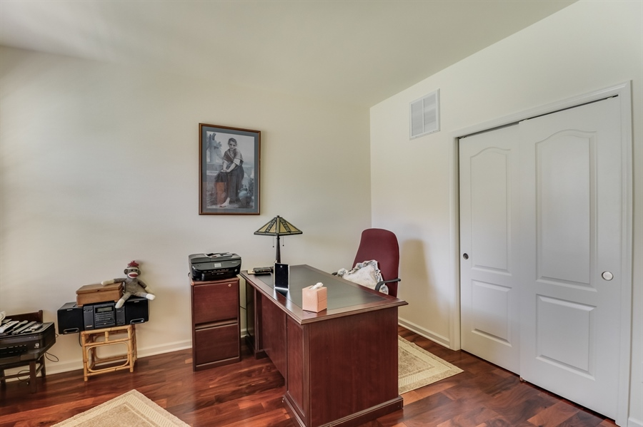 Real Estate Photography - 7771 Clydesdale Ct, Milford, DE, 19963 - Hardwood floor & closet in the office