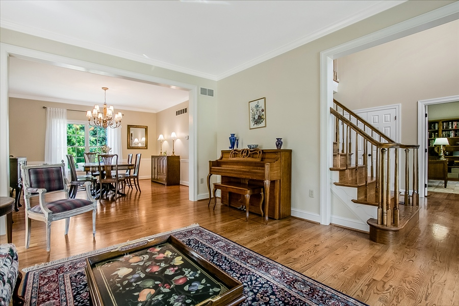 Real Estate Photography - 204 S Pond Rd, Hockessin, DE, 19707 - Open Living Room, Dining Room and Entrance Foyer