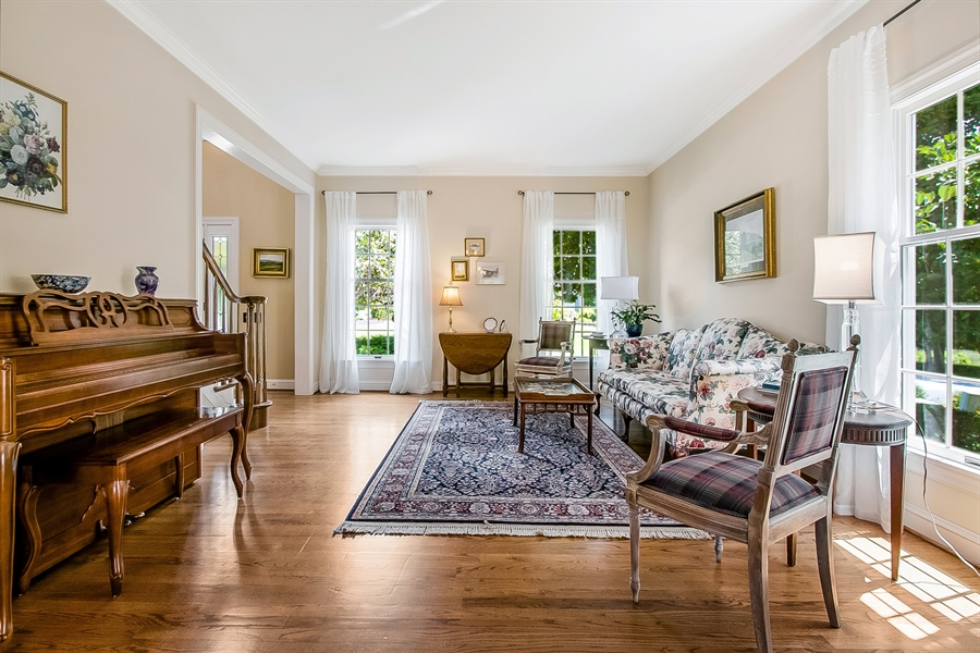 Real Estate Photography - 204 S Pond Rd, Hockessin, DE, 19707 - Lovely Living Room with Three Windows