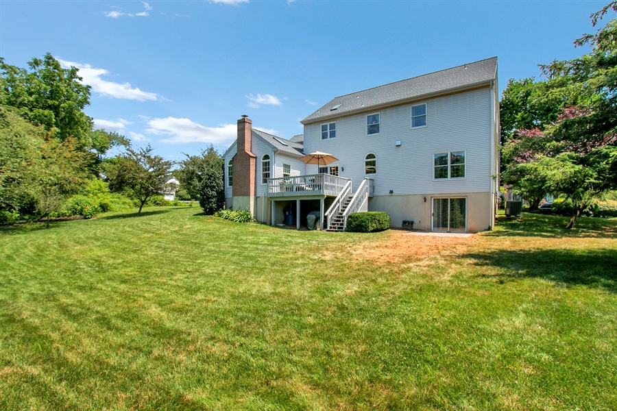Real Estate Photography - 204 S Pond Rd, Hockessin, DE, 19707 - Back of Home Showing Walk Out LL & New Patio