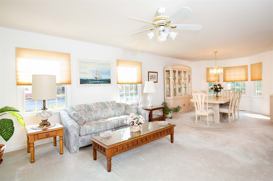 Real Estate Photography - 38047 Creekside Cir, Ocean View, DE, 19970 - Living Room Opens to Dining Room