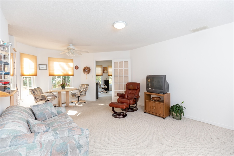 Real Estate Photography - 38047 Creekside Cir, Ocean View, DE, 19970 - Family Room Opens to Sunroom