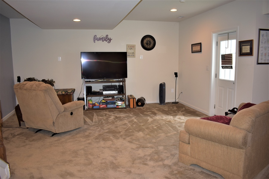 Real Estate Photography - 503 Maiden Ct, Middletown, DE, 19709 - Front Rm In Finished Basement W/ Walk Out Egress