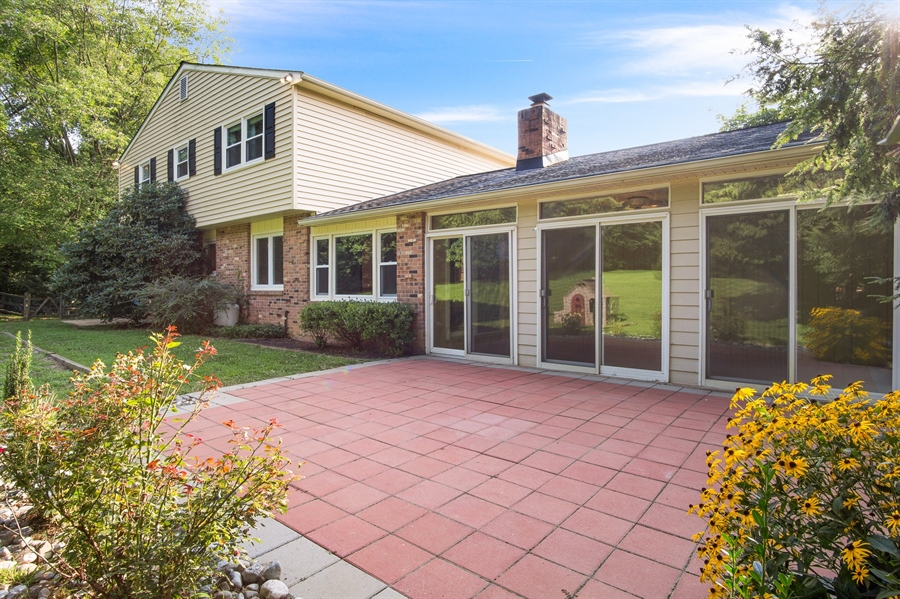Real Estate Photography - 200 Saturn Dr, Newark, DE, 19711 - Paver Patio Outside of Sun Room...All NEW Siding.