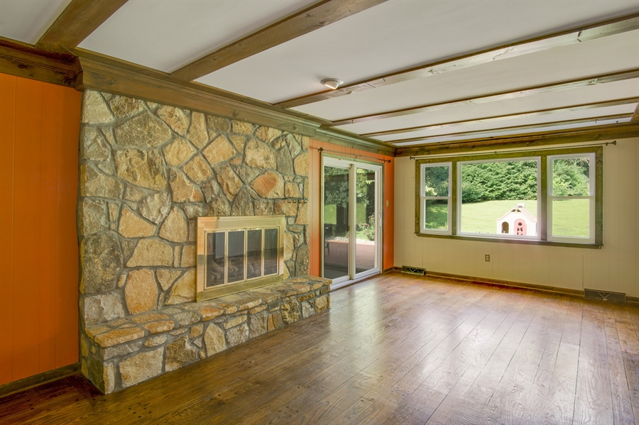 Real Estate Photography - 200 Saturn Dr, Newark, DE, 19711 - What a Fireplace In Family Rm w/Exposed Wood Beams