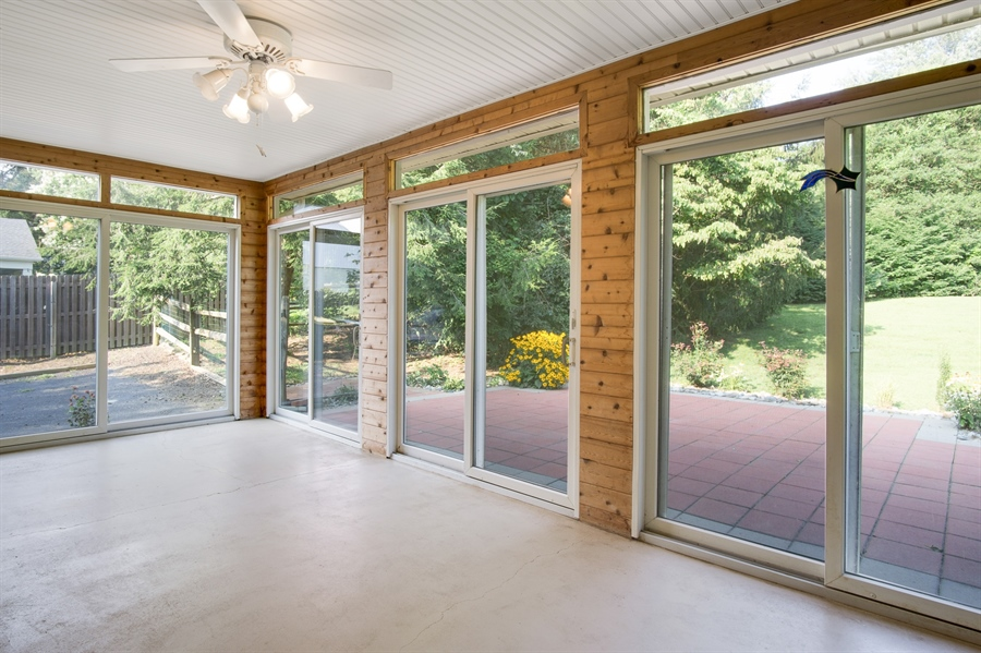 Real Estate Photography - 200 Saturn Dr, Newark, DE, 19711 - Sun Room is Surrounded by Anderson Sliders.
