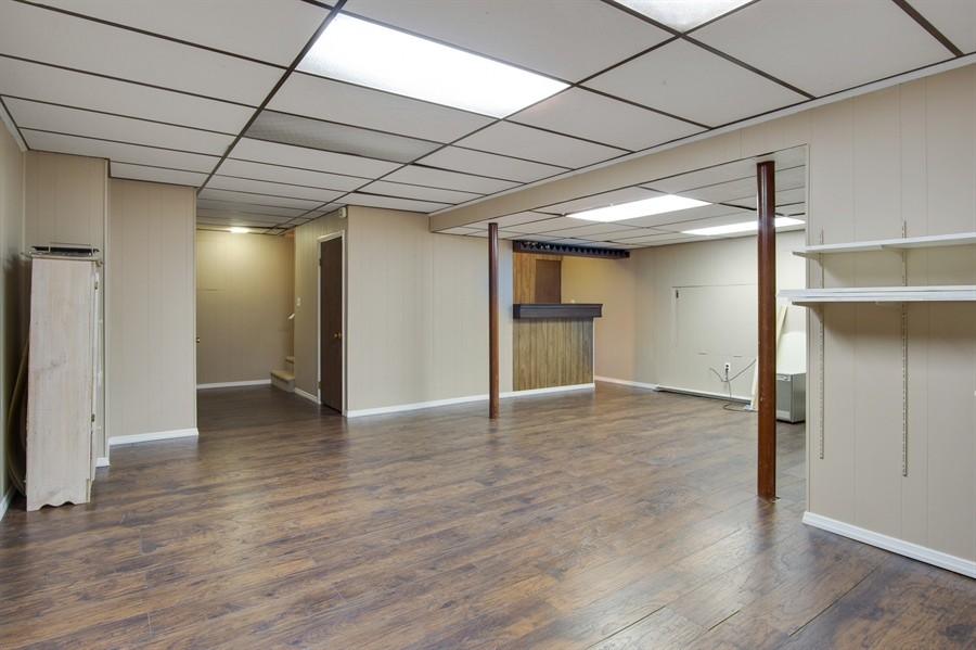 Real Estate Photography - 200 Saturn Dr, Newark, DE, 19711 - Finished Basement w/Bar and NEW Flooring.