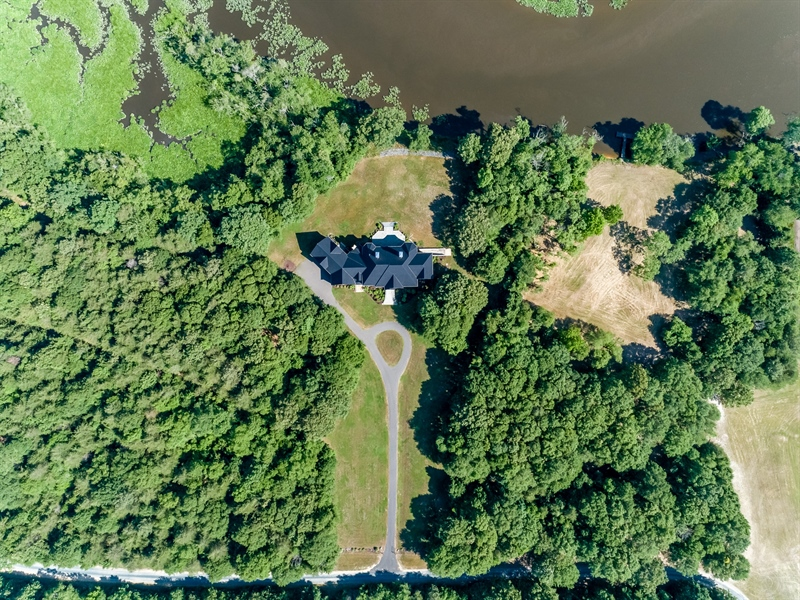 Real Estate Photography - 6393 Baileys Landing Drive, Bethel, DE, 19931 - AERIAL VIEW OF THE HOME AND WATERFRONT LOT