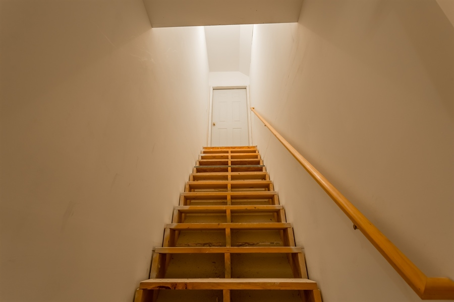 Real Estate Photography - 6393 Baileys Landing Drive, Bethel, DE, 19931 - STAIRS TO THE UNFINISHED 3RD FLOOR