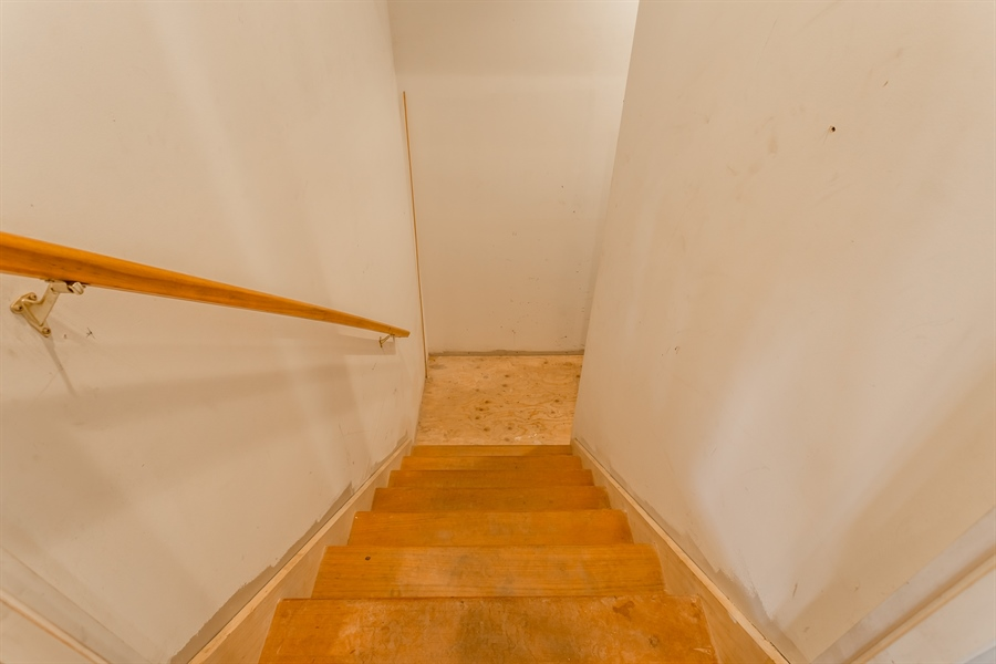 Real Estate Photography - 6393 Baileys Landing Drive, Bethel, DE, 19931 - STAIRS FROM THE UNFINISHED 3RD FLOOR