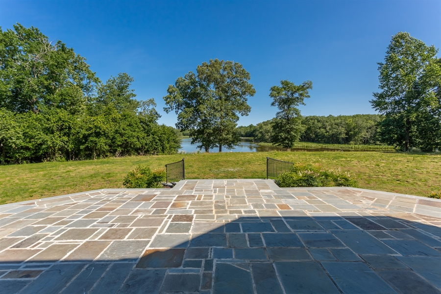 Real Estate Photography - 6393 Baileys Landing Drive, Bethel, DE, 19931 - EXPANSIVE PATIO FOR OPTIMUM WATER VIEWS