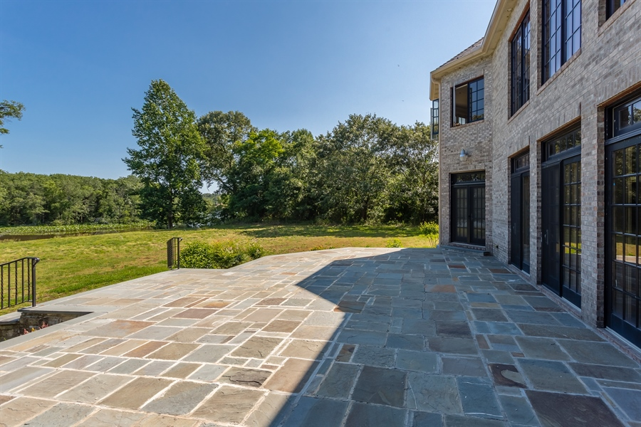 Real Estate Photography - 6393 Baileys Landing Drive, Bethel, DE, 19931 - EXPANSIVE REAR PATIO FOR OPTIMUM WATER VIEWS