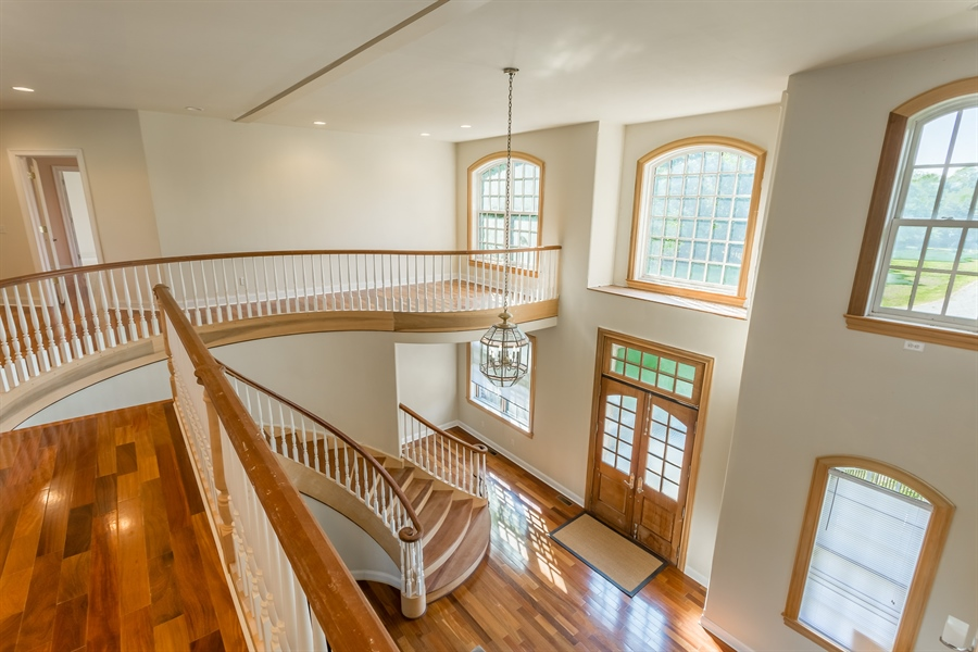 Real Estate Photography - 6393 Baileys Landing Drive, Bethel, DE, 19931 - VIEW OF THE FOYER FROM THE LOFT