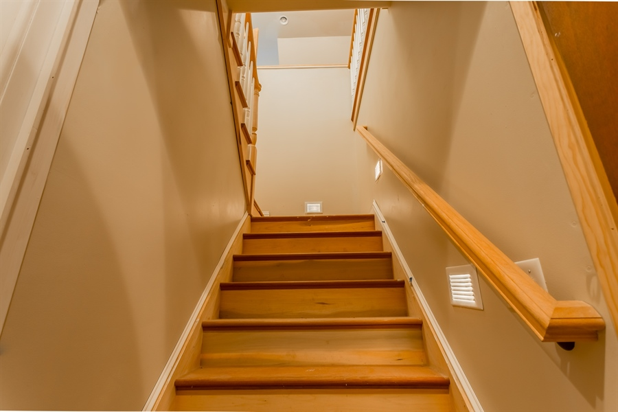Real Estate Photography - 6393 Baileys Landing Drive, Bethel, DE, 19931 - REAR STAIRCASE FROM THE HALL OFF OF THE KITCHEN