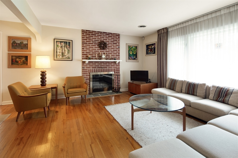 Real Estate Photography - 7 Council Trl, Wilmington, DE, 19810 - Living Room with wood burning fireplace