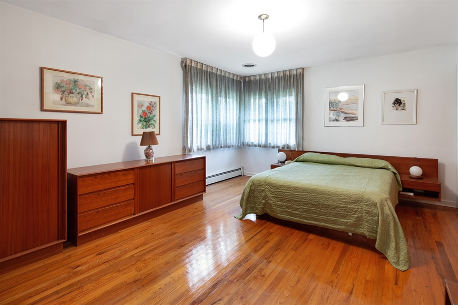 Real Estate Photography - 7 Council Trl, Wilmington, DE, 19810 - Master bedroom with beautiful hardwood floors