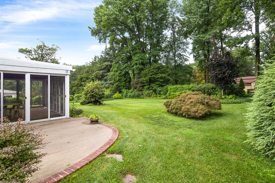 Real Estate Photography - 7 Council Trl, Wilmington, DE, 19810 - Large patio area off Screened Porch