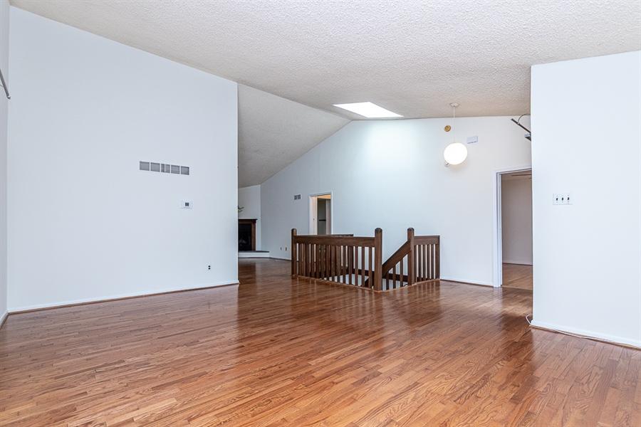 Real Estate Photography - 5518 Doral Dr, Wilmington, DE, 19808 - Liv Rm - Volume Ceiling and hardwoods