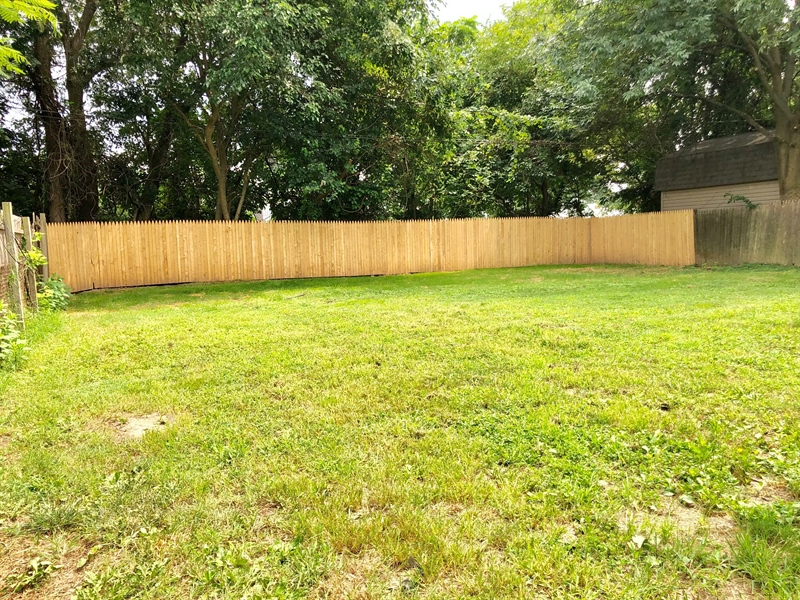 Real Estate Photography - 438 Howell Dr, New Castle, DE, 19720 - Huge Fenced in Backyard