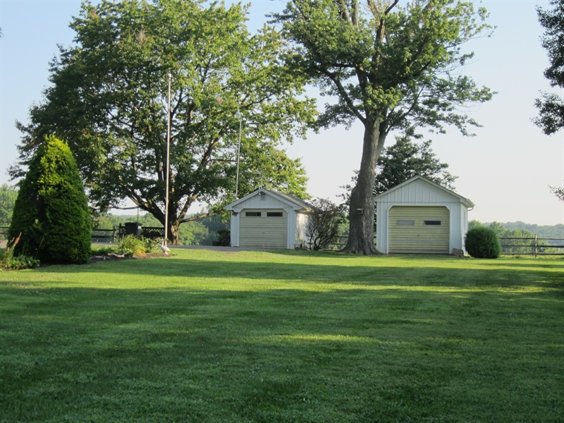 Real Estate Photography - 6159 Telegraph Rd, Elkton, MD, 21921 - Side Yard View, 2 sheds with electric