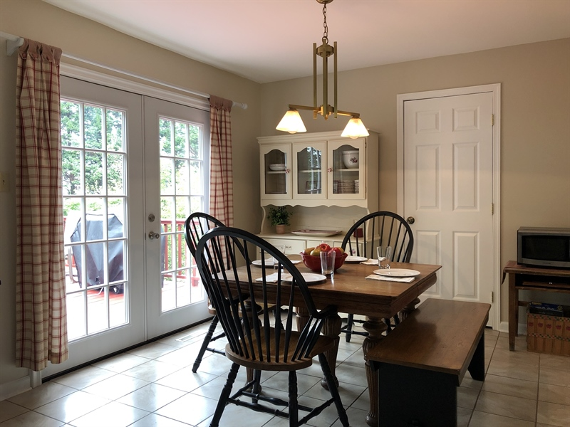 Real Estate Photography - 240 Tinsley Ct, Newark, DE, 19702 - Dining area with new sliders to deck and backyard