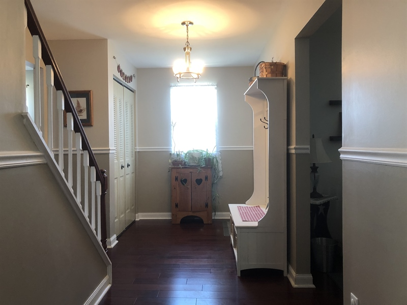 Real Estate Photography - 240 Tinsley Ct, Newark, DE, 19702 - Wide entry foyer also has coat closet