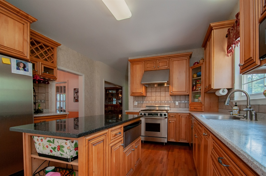 Real Estate Photography - 2 Lynam Lookout Dr, Newark, DE, 19702 - Spacious kitchen with granite island....