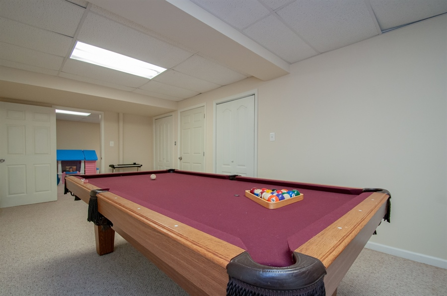 Real Estate Photography - 2 Lynam Lookout Dr, Newark, DE, 19702 - The basement has 3 finished rooms....game room....