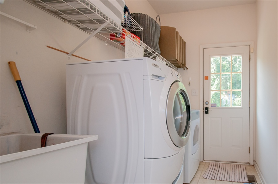 Real Estate Photography - 2 Lynam Lookout Dr, Newark, DE, 19702 - Main floor laundry room has a door to the back.