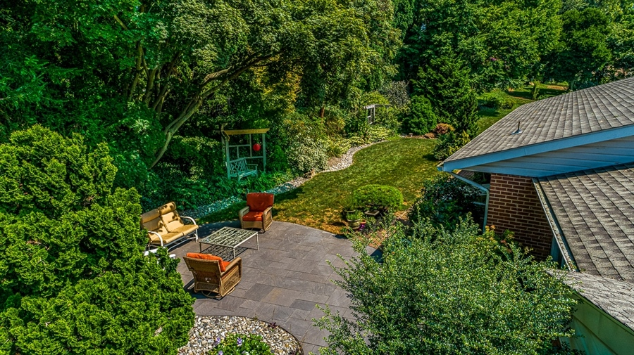 Real Estate Photography - 9 Crest Dr, Hockessin, DE, 19707 - Lush gardens surround the property