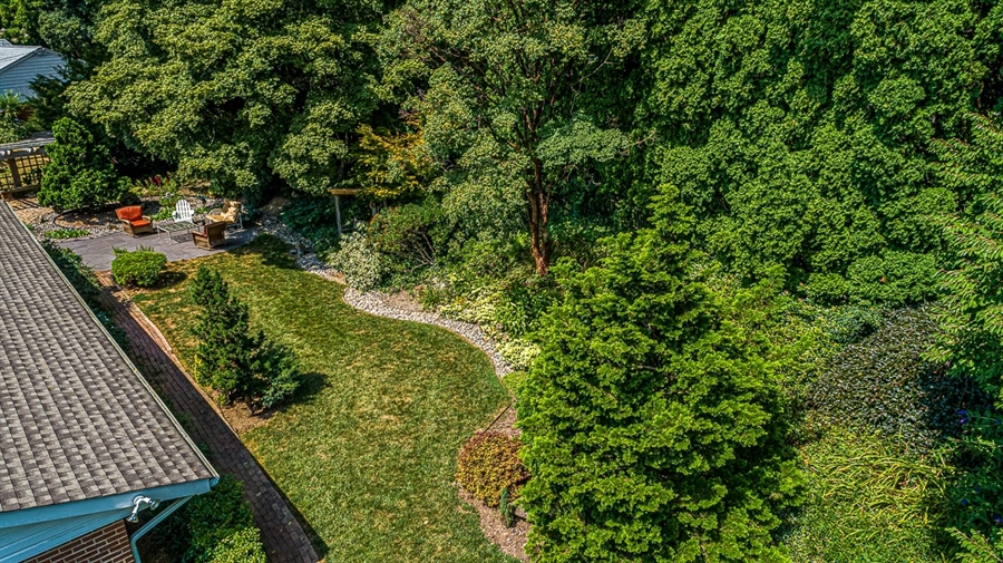 Real Estate Photography - 9 Crest Dr, Hockessin, DE, 19707 - Birds eye view of back yard seating area