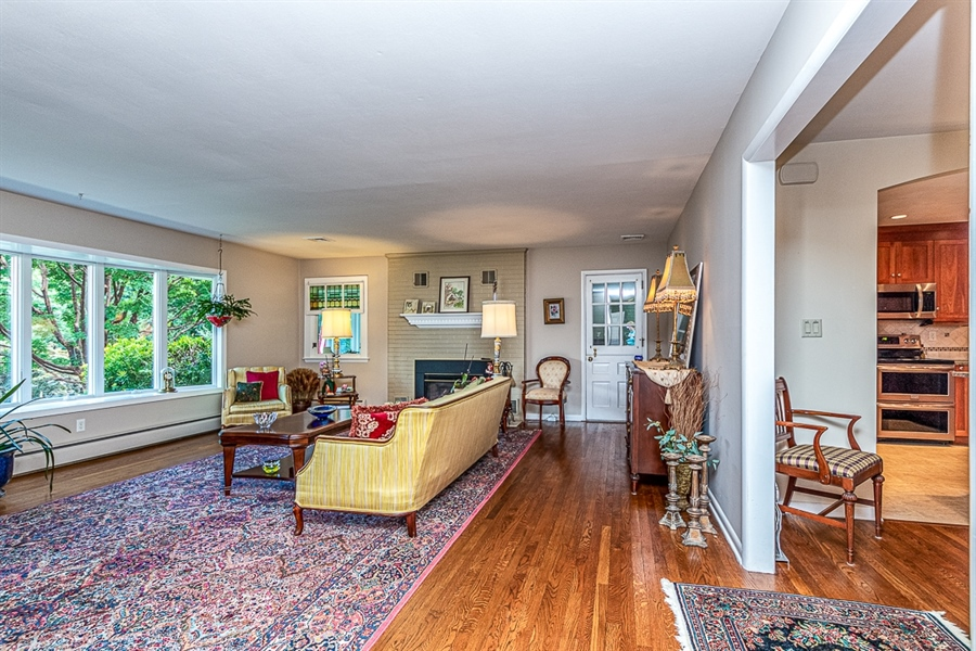 Real Estate Photography - 9 Crest Dr, Hockessin, DE, 19707 - Spacious living room open to dining room