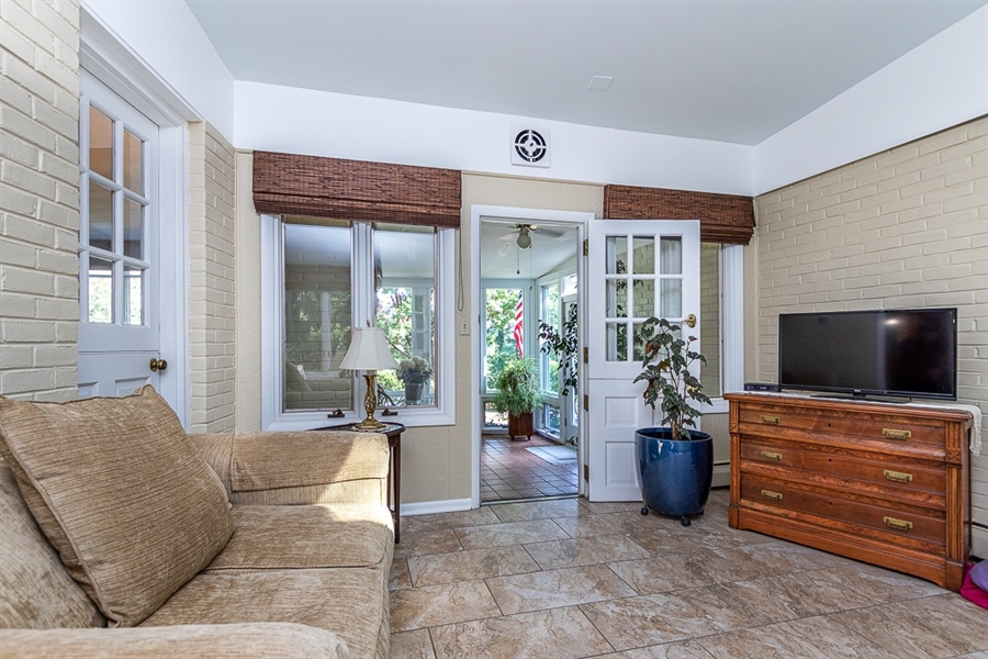 Real Estate Photography - 9 Crest Dr, Hockessin, DE, 19707 - Breezeway off the kitchen open to sun room