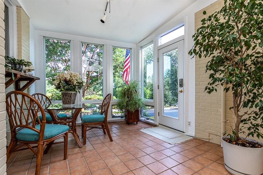 Real Estate Photography - 9 Crest Dr, Hockessin, DE, 19707 - Airy sun room with new Anderson windows