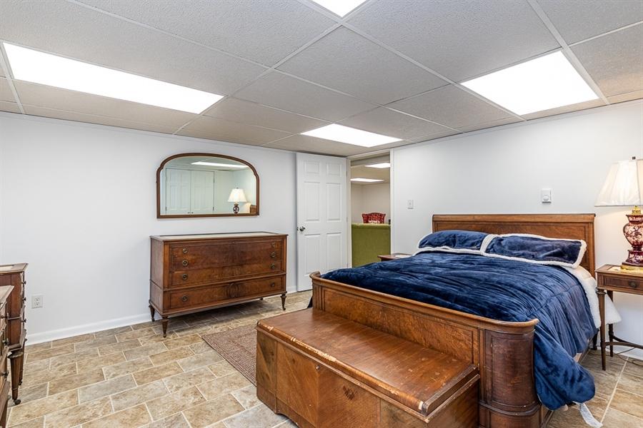 Real Estate Photography - 9 Crest Dr, Hockessin, DE, 19707 - Lower level room furnished as bedroom