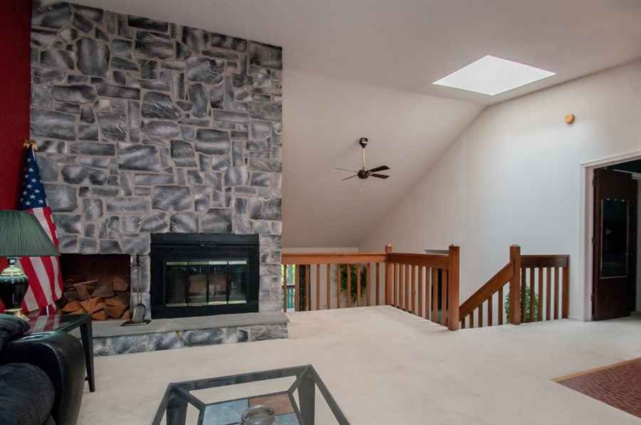 Real Estate Photography - 5455 Pinehurst Dr, Wilmington, DE, 19808 - The living room has a beautiful stone fireplace!