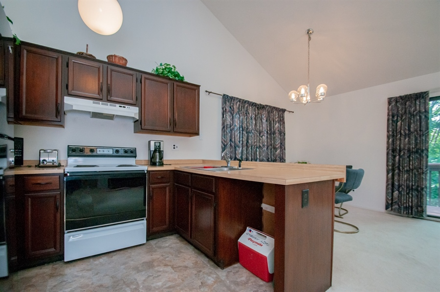 Real Estate Photography - 5455 Pinehurst Dr, Wilmington, DE, 19808 - ...with refinished cabinets.