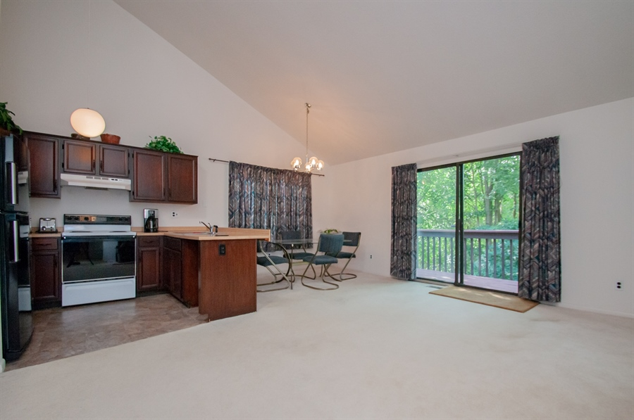 Real Estate Photography - 5455 Pinehurst Dr, Wilmington, DE, 19808 - The kitchen is open to the family room....