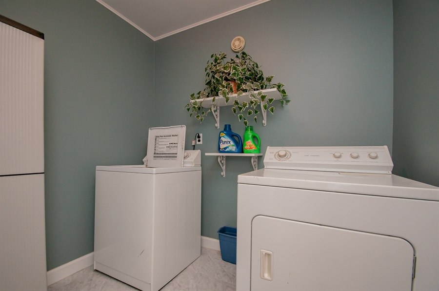 Real Estate Photography - 5455 Pinehurst Dr, Wilmington, DE, 19808 - Down one more level to the laundry room....