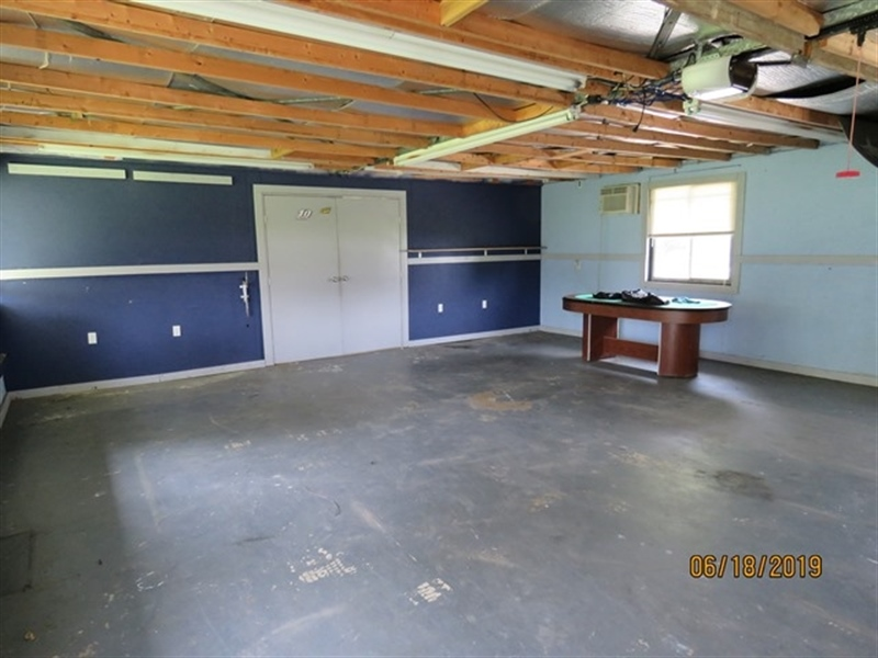 Real Estate Photography - 21750 Maple Dr, Seaford, DE, 19973 - Garage Interior