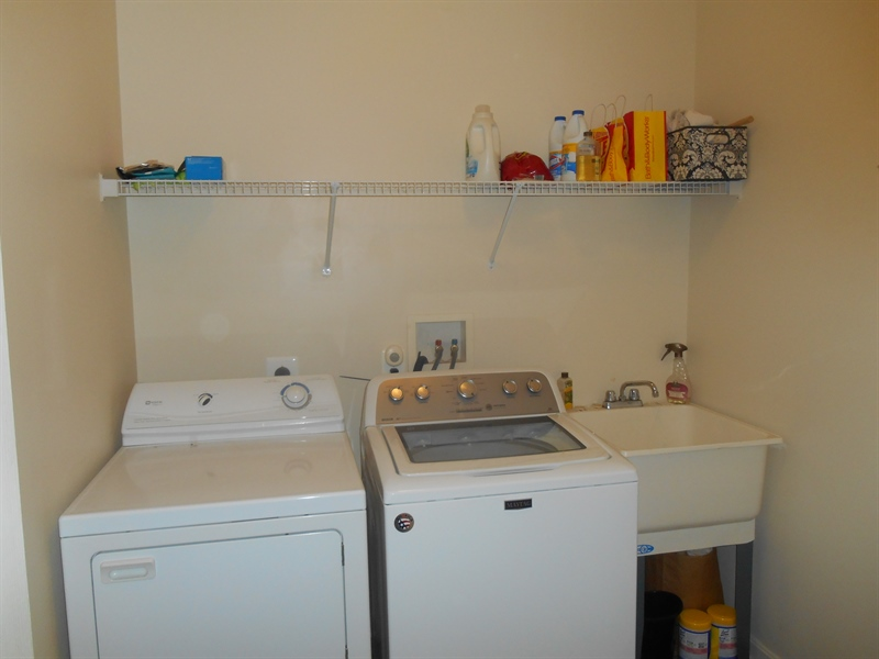 Real Estate Photography - 64 Buntings Mill Ct, Selbyville, DE, 19975 - Laundry Room
