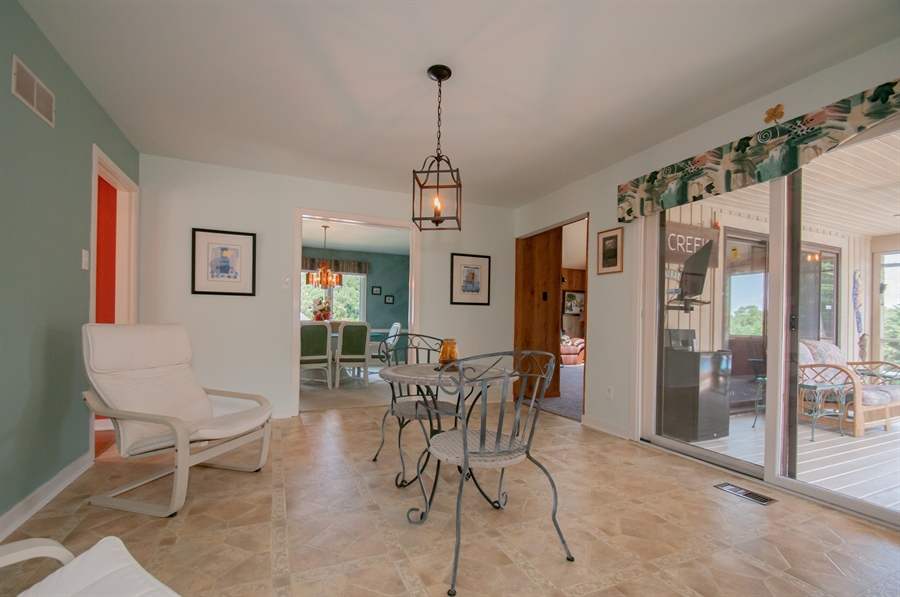 Real Estate Photography - 205 Louis Ln, Hockessin, DE, 19707 - Breakfast Area leads to Porch
