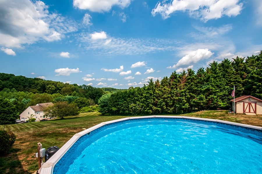 Real Estate Photography - 205 Louis Ln, Hockessin, DE, 19707 - Inviting Above Ground Pool w/ Spectacular Views