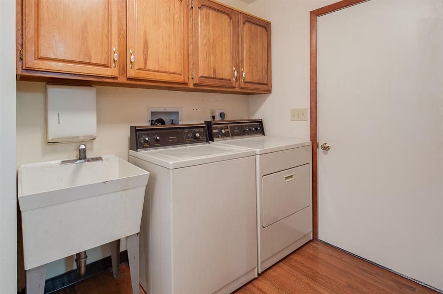 Real Estate Photography - 270 Delaplane Ave, Newark, DE, 19711 - Main floor laundry with storage cabinets