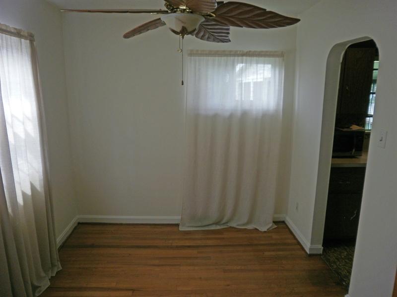Real Estate Photography - 404 Stanton Rd, Wilmington, DE, 19804 - Hardwood floors & fan in the dining room