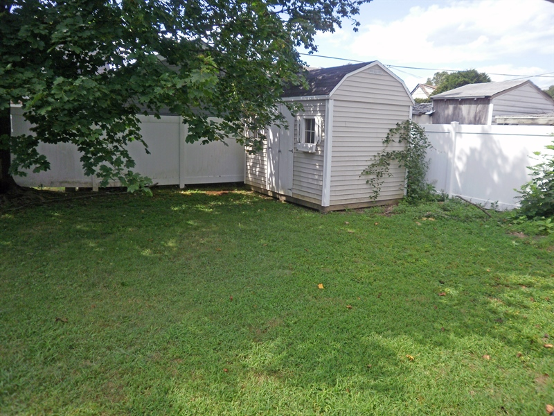 Real Estate Photography - 404 Stanton Rd, Wilmington, DE, 19804 - Vinyl fenced rear yard and shed included