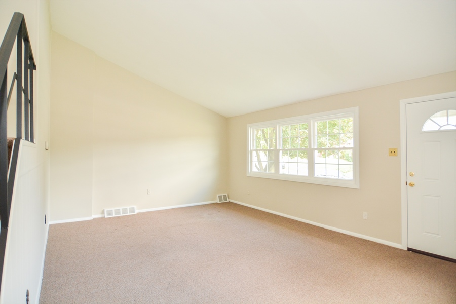 Real Estate Photography - 178 Wiltshire Rd, Claymont, DE, 19703 - Living Room with new carpet, new windows, new door